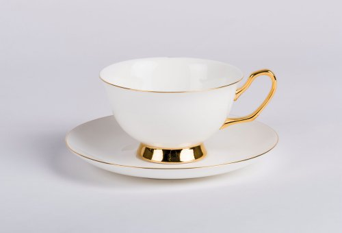 Gold Rimmed Tea Cup and Saucer $40